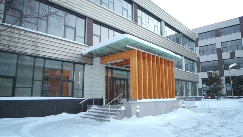Entrance to business center and courtyard at winter snowy day