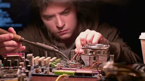 Shifting focus from processor to computer expert with soldering iron
