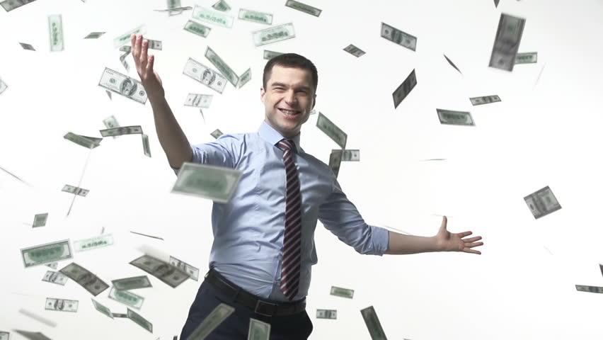 Man triumphing under falling bills | Shutterstock HD Video #6071129