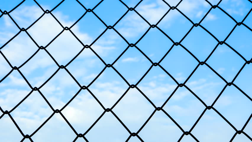 time-lapse of steel cage with blue sky and cloud moving in background