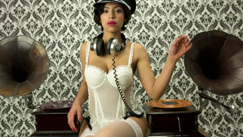 beautiful sexy disco woman in white lingerie with gramophones and record vinyls. Useful for fashion, beauty, music and events