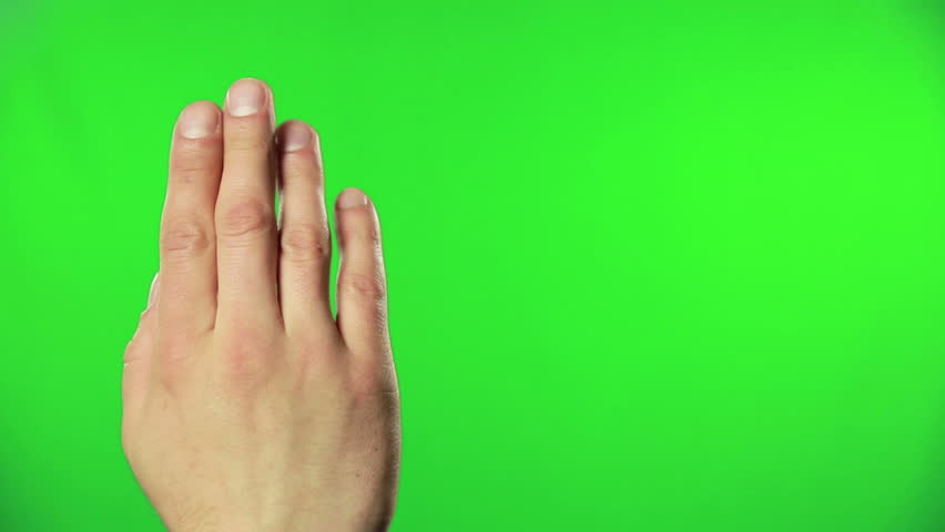 Human hand accessing online data using green screen technology, close up