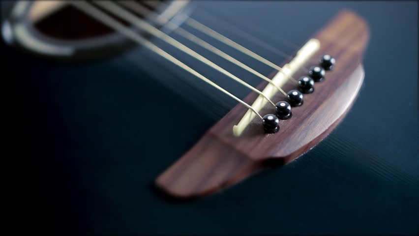 Accoustic guitar blue and black on white background diagonal motion