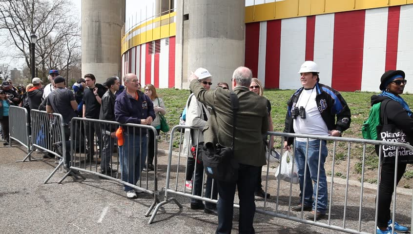 New York, NY - April 22, 2014: People waiting in line to access New York State Pavilion on day of celebration of 50th anniversary of World's Fair in Queens Flushing Meadows Park