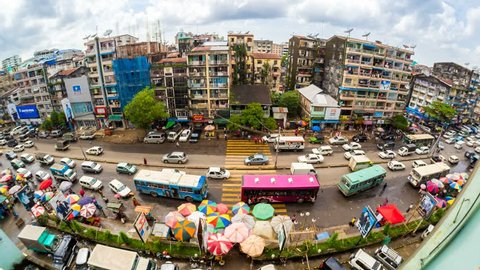 YANGON - AUG 27: Timelapse view of a busy city street market in central Yangon showing people going about their daily lives in the economic center of the country on 27 August 2013 in Yangon, Myanmar