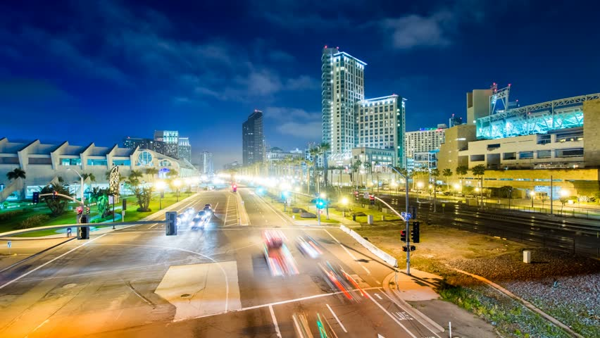 SAN DIEGO - 15 MAR: Timelapse view over central San Diego city by night showing moving traffic and people over a pedesrian bridge on 15 March 2013 in San Diego, USA