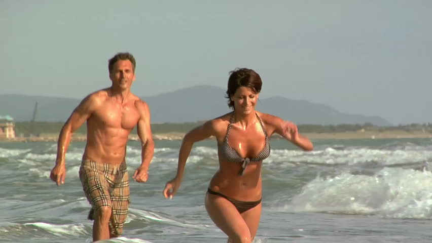 Man and woman running on the beach