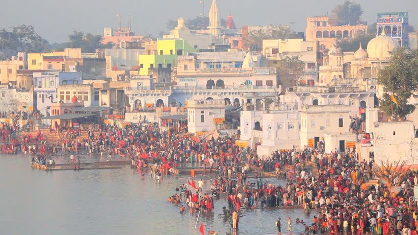 Pilgrims bathing in the sacred holy lake at pushkar in ajmer pilgrims bathing in the sacred holy lake at pushkar in ajmer district rajasthan india altavistaventures Image collections