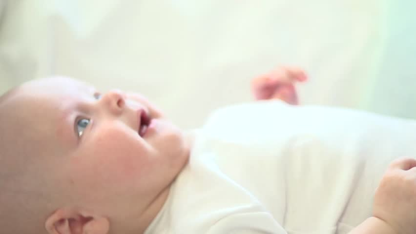 f4554f8b4 Newborn baby smiling. Close-up. Healthy Adorable Infant Laughing. Slow  motion Video Footage full hd 1080. High speed camera 240 fps