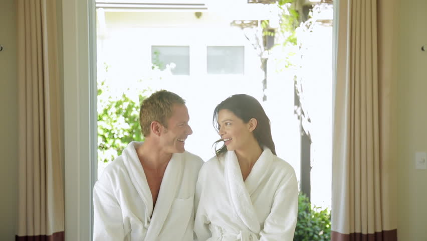 Romantic couple relaxing in their bathrobes at the spa after a massage  together