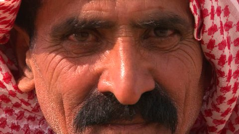 PALESTINIAN TERRITORIES, ISRAEL CIRCA 2013 - Close up of a face of a Palestinian Bedouin man in headscarf.