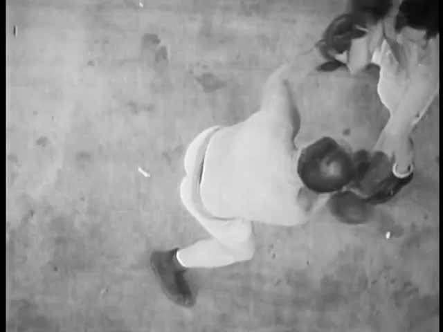 High angle view of boxer knocking out opponent