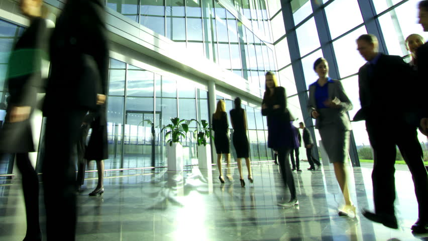 Time lapse of diverse business group in a large modern corporate building | Shutterstock HD Video #6283148