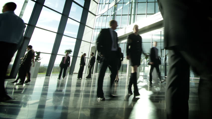 Time lapse of diverse business group in a large modern corporate building | Shutterstock HD Video #6283538