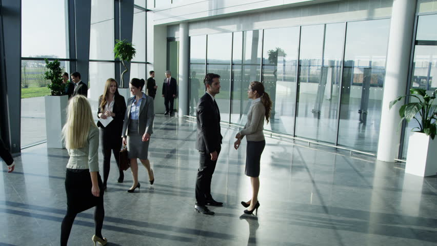 Business people having a conversation in large modern office building | Shutterstock HD Video #6285761