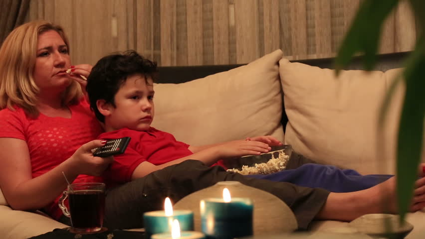 Dolly Shot Mother And Son Eating Popcorn And Watching Comedy Movie Stock Footage Video -5210