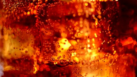 Cola with ice cubes background. Cola with Ice and bubbles in glass. Soda closeup. Food background. Stock full HD video footage 1920x1080p, 1080