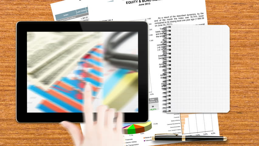 Hand sliding business pictures on electronic tablet