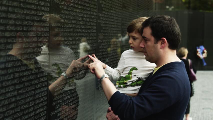 Medium Shot Father and son (4-5) at Memorial Wall, Vietnam Veterans Memorial, Washington D.C, USA