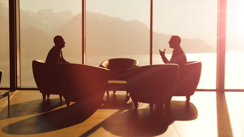 Business discussion talking. silhouette. business background. handshake. company career corporate. cooperation. professionals. luxury interior. business meeting. 2 businessman having a conversation | Shutterstock HD Video #6344369