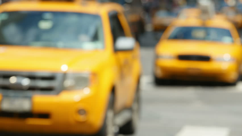 Taxis and other vehicular traffic move through Times Square in New York City.