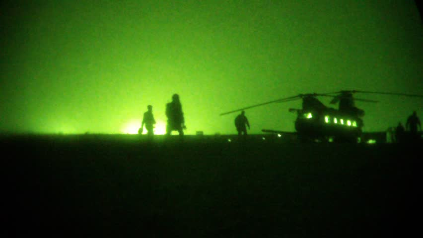 Night Vision: Soldiers walk toward chinook helicopter