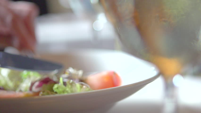 Person eating delicious salad in a restaurant young man enjoying healthy food fresh vegetable salad close up slow motion video footage slowmo slow mo high speed camera shot stock footage video 6399248 shutterstock forumfinder Image collections