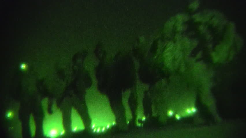Night Vision: Low Angle View of Special Ops Soldiers with Weapons Walking off on Mission