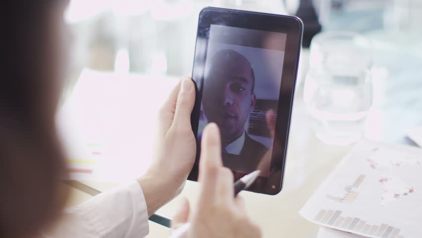 Office workers have meeting on tablet   Shutterstock HD Video #6495668