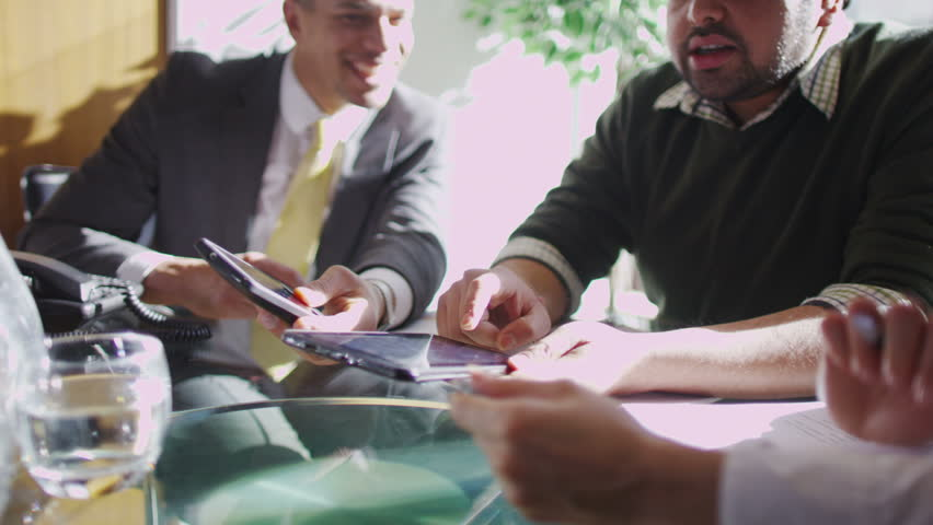 Office workers discuss plans | Shutterstock HD Video #6496730