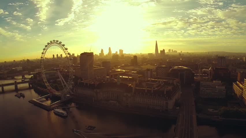 Aerial panorama of central London, UK. Features the River Thames, Millennium Wheel (London Eye), Waterloo and Houses of Parliament. | Shutterstock HD Video #6525038