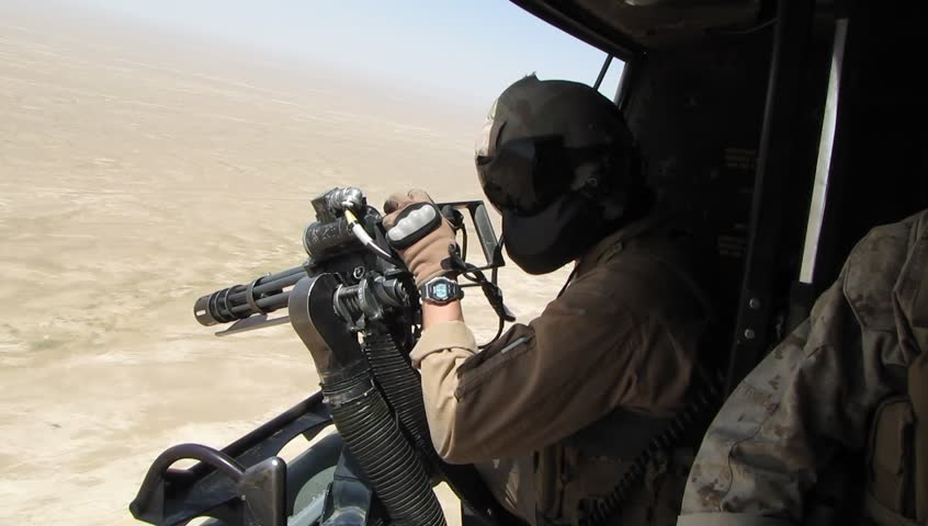 Helicopter Door Gunner Looks for Target over Desert of Middle East - HD stock video clip & Helicopter Door Gunner Looks For Enemy Target Stock Footage Video ...