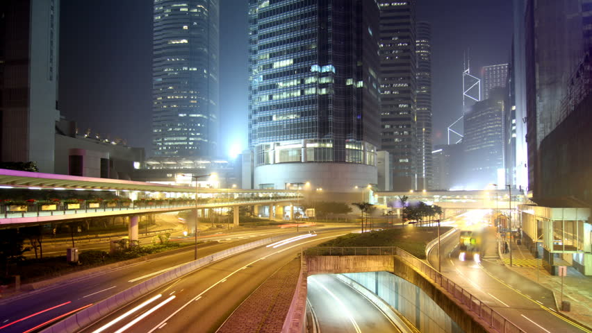 Cityscape timelapse at night. Hong Kong. Busy traffic across the main road at rush hour. #652837