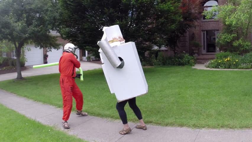 Astronaut fighting a robot. nonsense concept.
