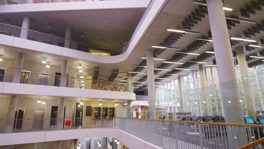 Diverse group of students in large modern university building | Shutterstock HD Video #6555128