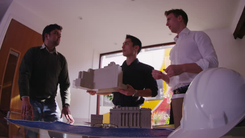 Coworkers using model building | Shutterstock HD Video #6558908