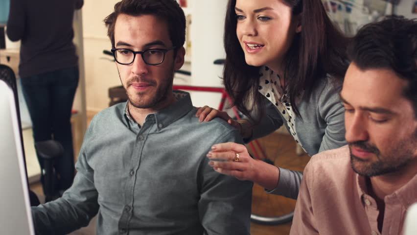 Creative business team meeting in trendy hipster office discussing new ideas. Female manager or colleague giving direction. | Shutterstock HD Video #6565328