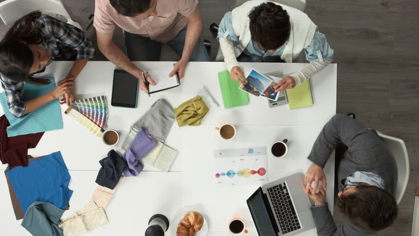 Creative business meeting from above of hipster startup teamwork | Shutterstock HD Video #6565337