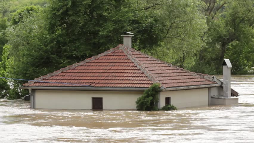 Flooded house after storm,water flowing through the house,close up.River rushes and spilling,ruined home.Natural disasters,catastrophe,rainstorm,thunderstorm,hurricane,tsunami,tornado,typhoon.
