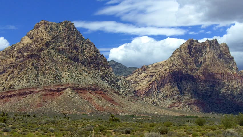 A beauty shot of colorful mountains in Red Rock Canyon National Conservation Area near Las Vegas, NV. This area is overseen by the Bureau of Land Management through taxpayer funds.  | Shutterstock HD Video #6597608