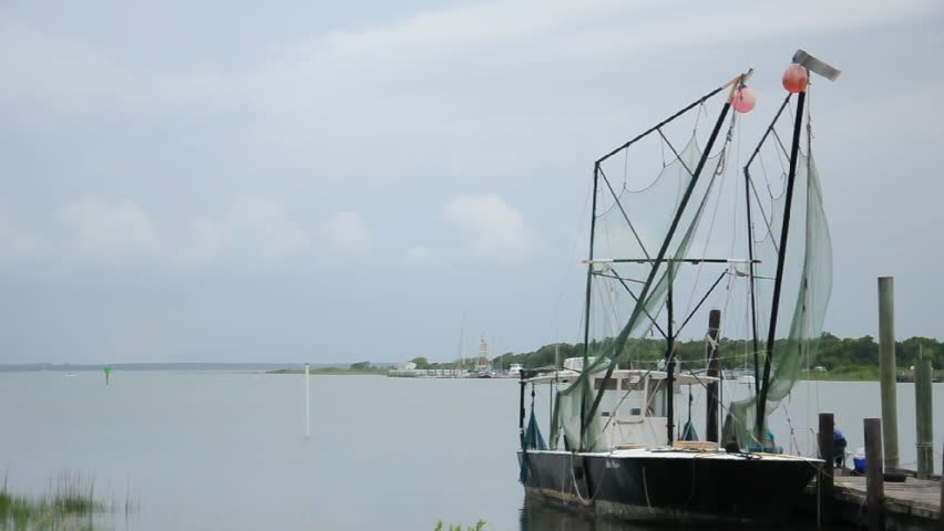 Shrimp trawler boats moored at a dock on the coast of North Carolina