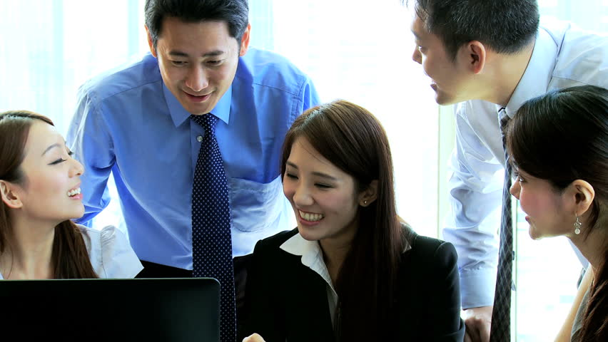 Asian Chinese successful business team conference together modern city boardroom discussing latest financial results seen laptop computer touch screen tablet | Shutterstock HD Video #6643646