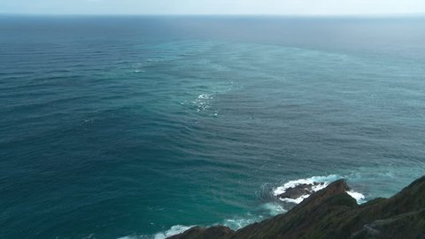 This is the point where the two oceans meet(actually the Tasman sea and the Pacific Ocean)at the northern most point in New Zealand: Cape Reinga. Time lapse