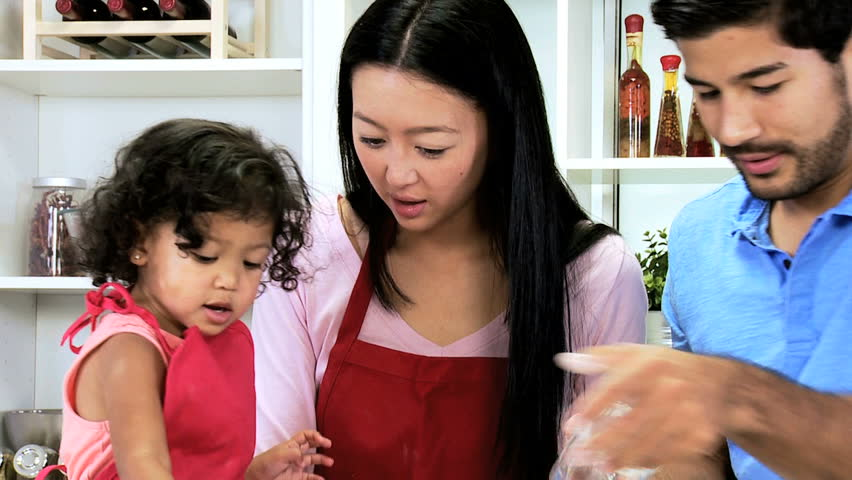 Family group Asian Chinese parents cute baby girl enjoying baking together making homemade cookies home kitchen counter close up | Shutterstock HD Video #6654248