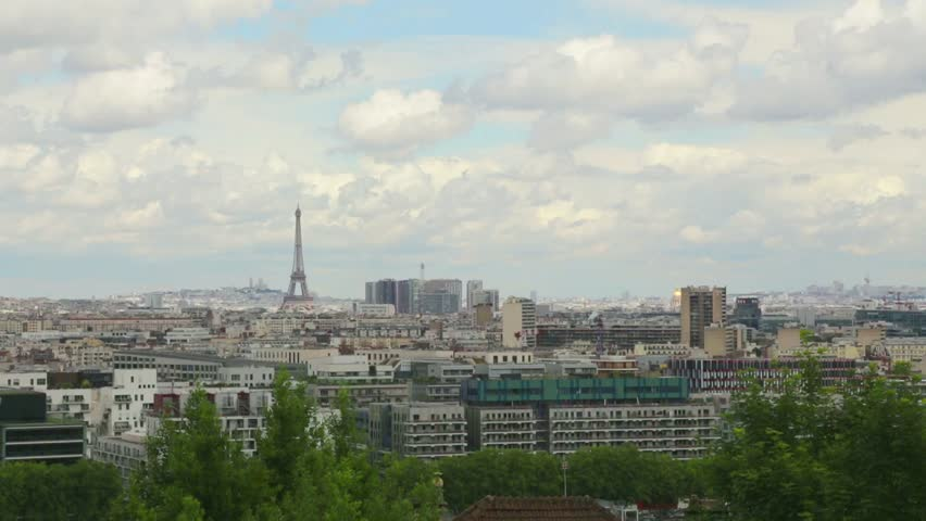 Establishing shot, Eiffel tower, Paris, old apartment building. Pan right. | Shutterstock HD Video #6694418