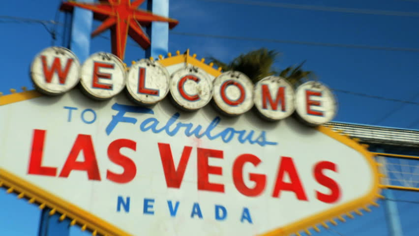 Crash zoom of famous illuminated Las Vegas welcome sign  | Shutterstock HD Video #673108
