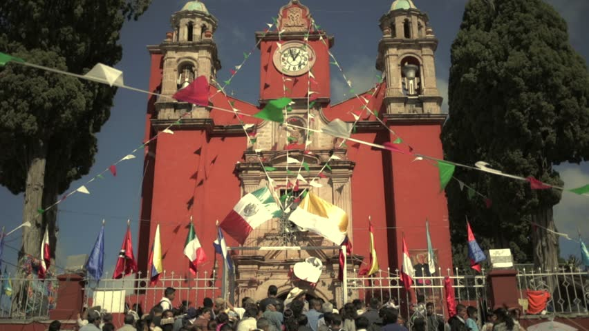 GUANAJUATO, MEXICO -CIRCA 12 DECEMBER 2013: Pilgrims on the Mexican church's entrance during the celebration to the Virgin of Guadalupe
