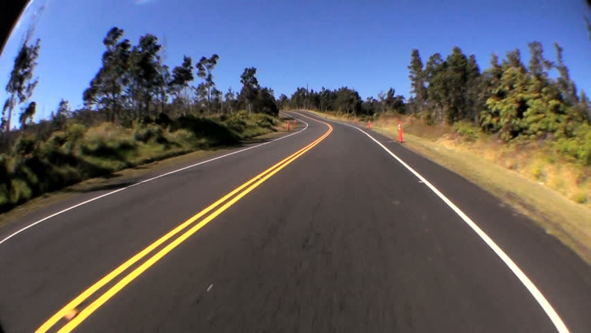 Time-lapse point-of-view fish-eye driving a metalled road through rural countryside