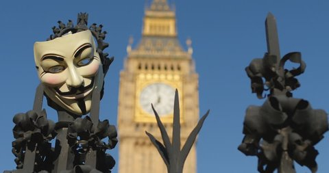 Revolution, Guy Fawkes mask and Big Ben.  Protest in  London June 2014, the Peoples Assembly that puts people and planet before profit.