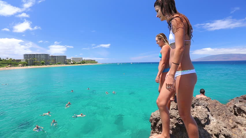 Group of friends jumping from cliff into the ocean in Hawaii. Summer fun lifestyle. | Shutterstock HD Video #6796648
